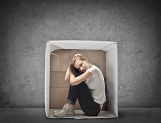 Blonde Girl Smiling Crouched in a Box