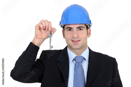 Engineer holding up a key