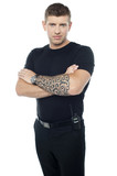 Bouncer with walkie-talkie. Tattoo on hands poster