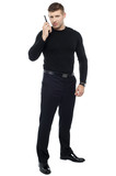 Bodyguard communicating via walkie-talkie poster