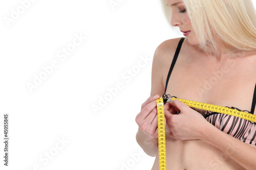 Woman measuring her bust