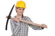 Tradeswoman holding a pickaxe