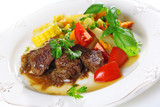Traditional goulash or beef stew with vegetables and salad of fr