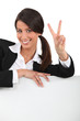 portrait of a businesswoman doing V-sign