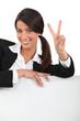 portrait of a businesswoman doing V-sign