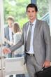 Teacher carrying briefcase opening door