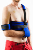 Male patient with injured arm and schoulder wearing blue brace