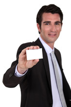 Man Holding Up A Blank Business Card Sticker