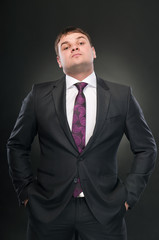 A young man in a suit with his head high. looks down.