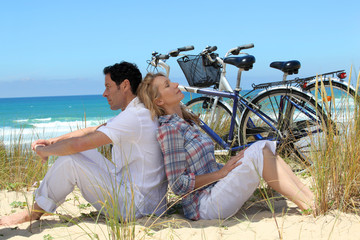couple on the beach with bikes