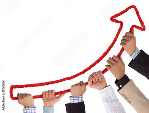 Business hands holding red arrow pointing upwards