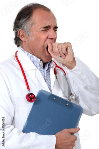 Tired doctor yawning
