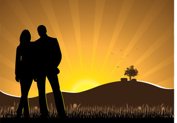 Silhouette of a couples on grass during sunrise