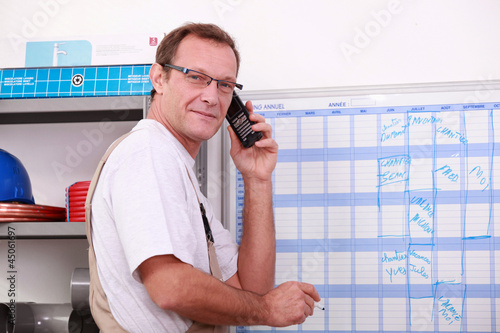 worker planning on a board