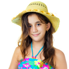 Hispanic girl wearing a swimsuit and a straw hat