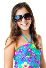 Hispanic girl wearing a swimsuit and  sunglasses