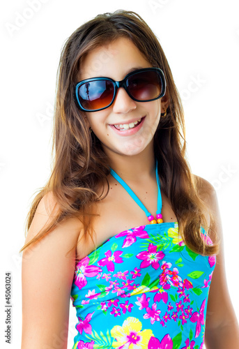 Hispanic girl wearing a swimsuit and  sunglasses