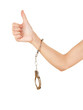 woman hand with handcuffs and thumb up