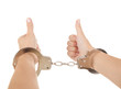 woman hands with handcuffs and thumbs up