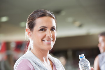 Woman Holding Bottle Of Water At Health Club