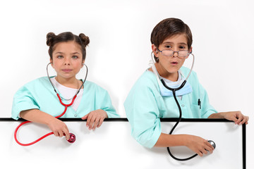 Children dressed as doctors