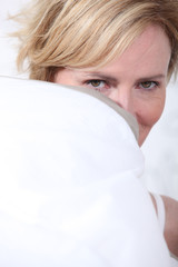 Wife behind pillow