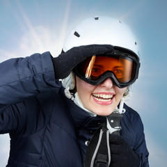 Young skiing woman looking for fun in winter sports