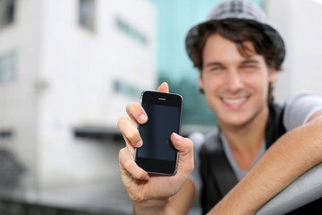 Closeup on smartphone screen hold by young man