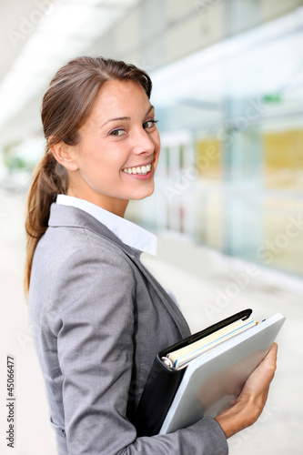 Portrait of beautiful businesswoman standing outside building