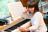 Portrait of cute little girl at piano.