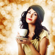 Attractive brunet woman with a cup of coffee
