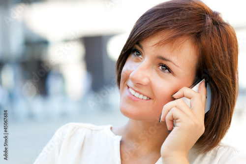 Beautiful woman speaking on the phone outdoor