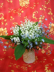 Bouquet of lilies of the valley and blue flowers