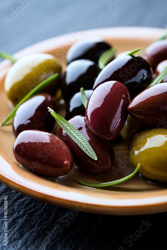 Marinated olives with rosemary on a plate