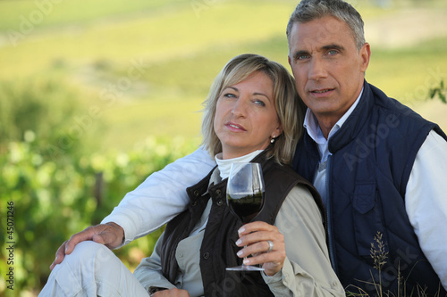 Married couple tasting wine
