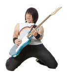 """Young man kneeling and playing electric guitar, studio shot"""