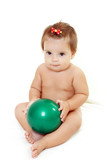 baby girl holding green ball