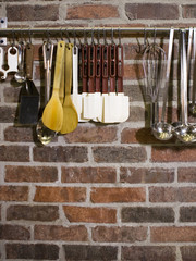"""USA, Utah, Orem, close-up of cooking utensils hanging on rail"""