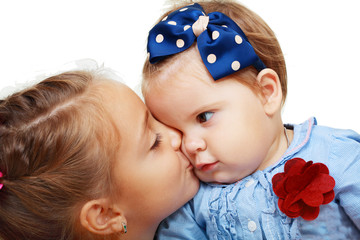 Big sister and little sister kissing