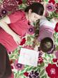 """USA, California, San Francisco, pregnant mother with daughter (2-3) coloring"""