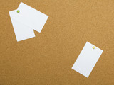 Three blank papers pinned to notice board