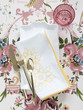 Plate with napkin and cutlery on floral tablecloth