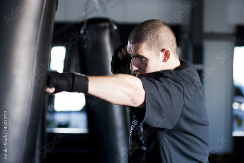 """USA Utah, American Fork, Boxer punching boxing bag"""