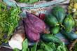 Banana flowers and green papaya on asian food market