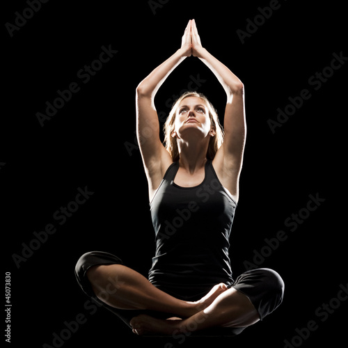 Young woman doing yoga, studio shot