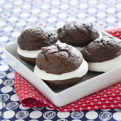 """Chocolate cakes with cream, studio shot, close-up"""