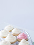 """Cupcakes with frosting on silver tray, close-up, copy space"""