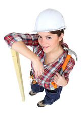 Female carpenter with a hammer