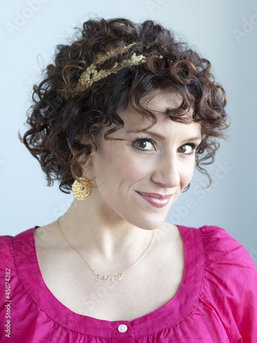 """Young woman smiling, portrait, studio shot"""