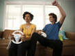 """""""USA, Utah, Provo, young couple playing video games in living room"""""""